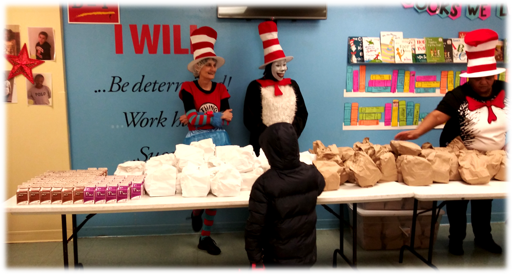 Three Cafeteria staff members dressed in Dr Suess themed attire serving students Grab and Go Breakfast.